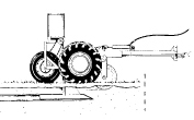 Figure 9. A tractor-drawn mechanical burrow builder machine can be used to control pocket gophers. It automatically dispenses toxic bait into the artificial burrow it creates.